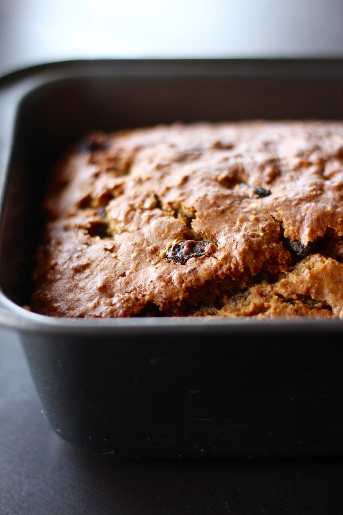 Walnut Raisin Bread cooling in a loaf pan
