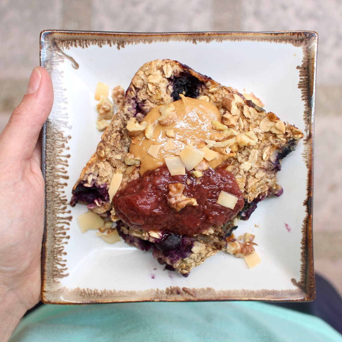 berry baked oatmeal topped with peanut butter and strawberry chia jam