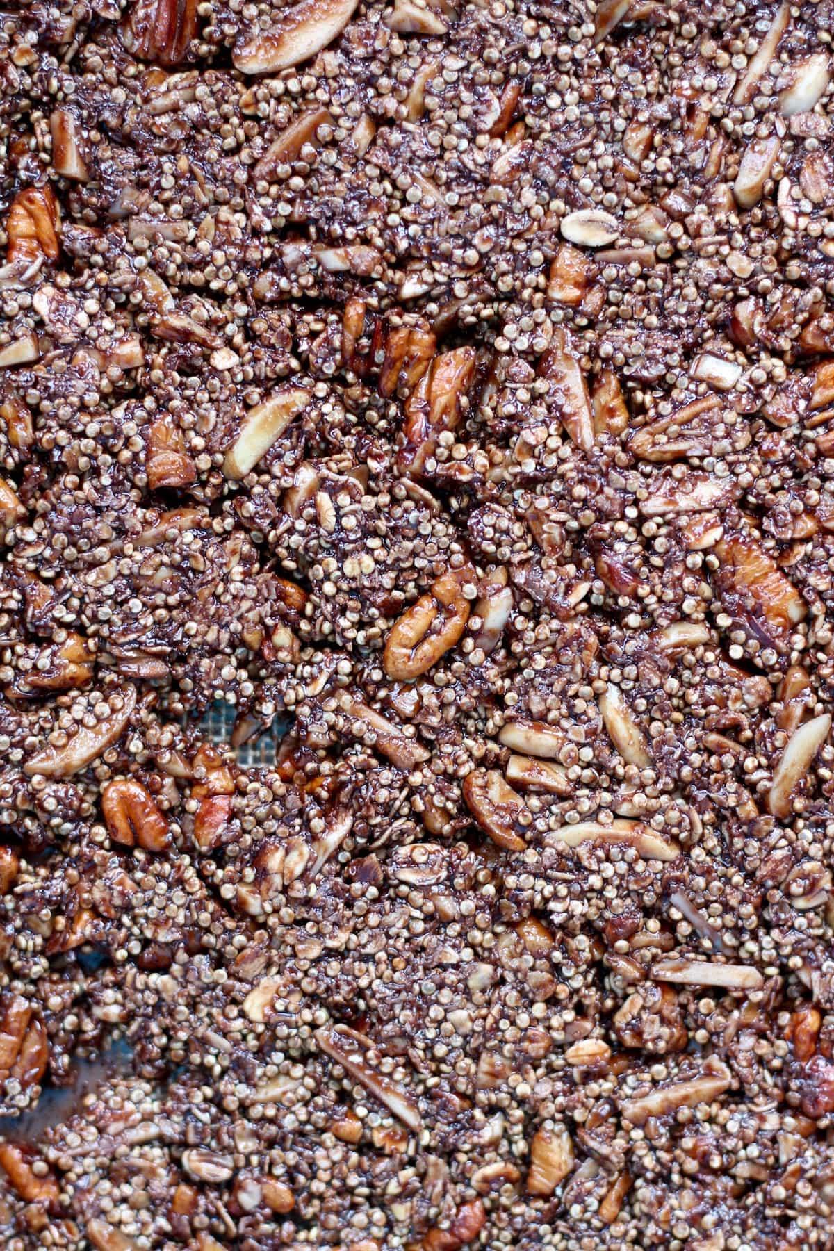 chocolate quinoa granola pressed flat on a baking tray