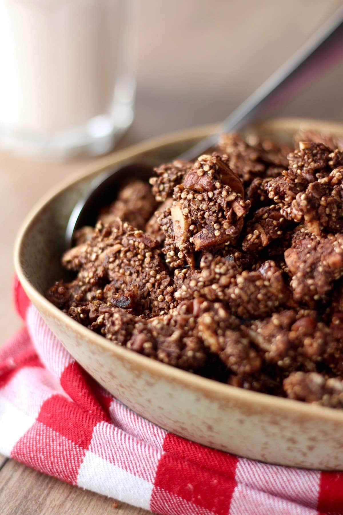chocolate quinoa granola piled high in a bowl