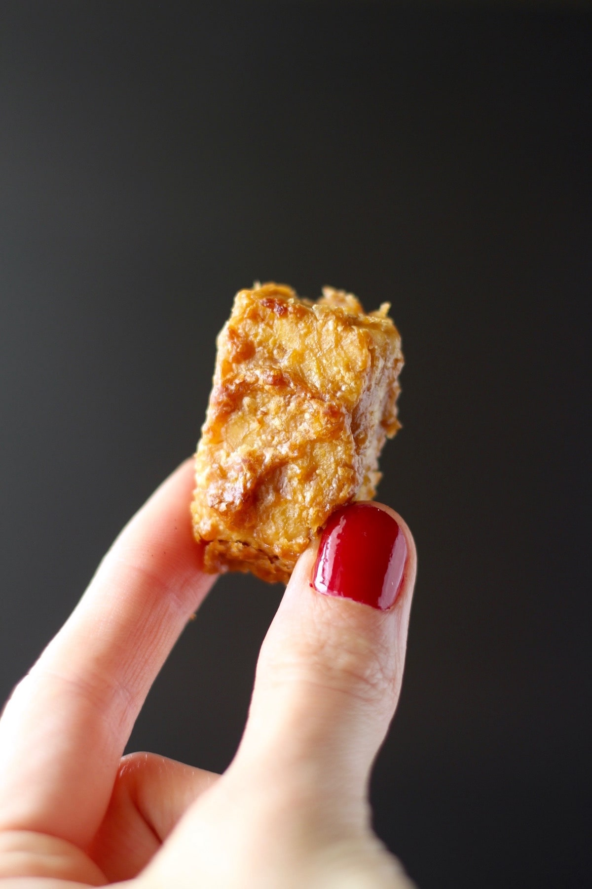 A golden brown baked tempeh bite