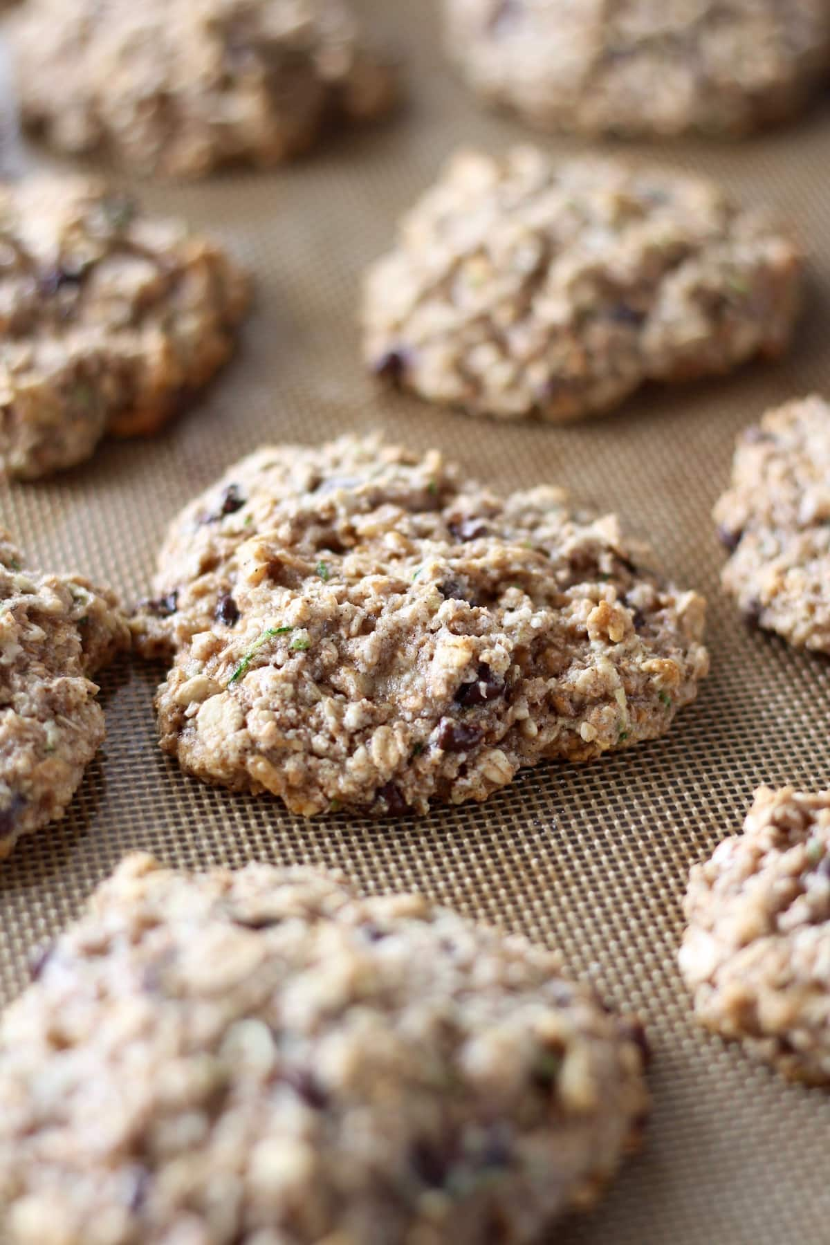 chocolate chip zucchini oatmeal cookies on a silicone baking mat