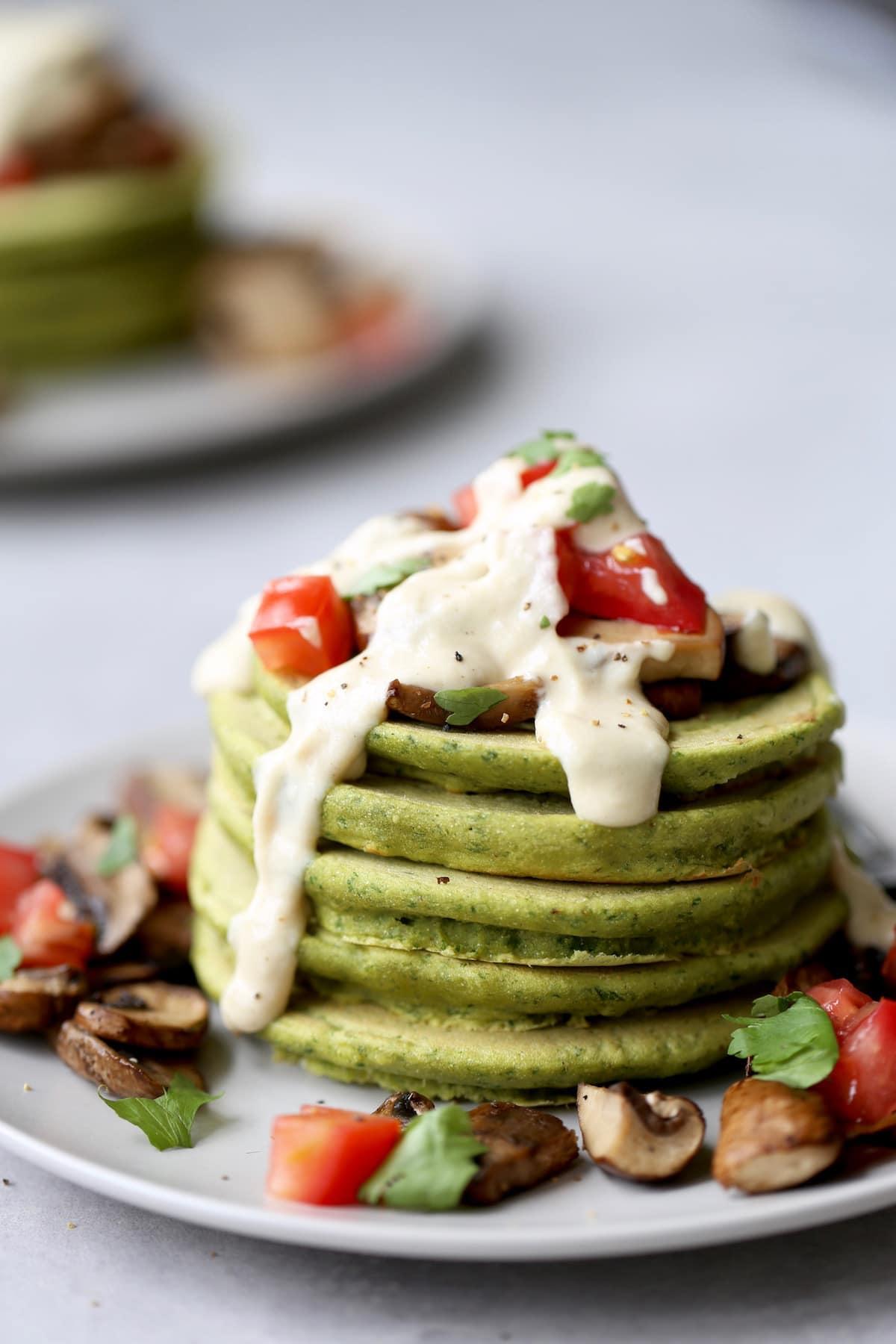 a stack of green falafel pancakes