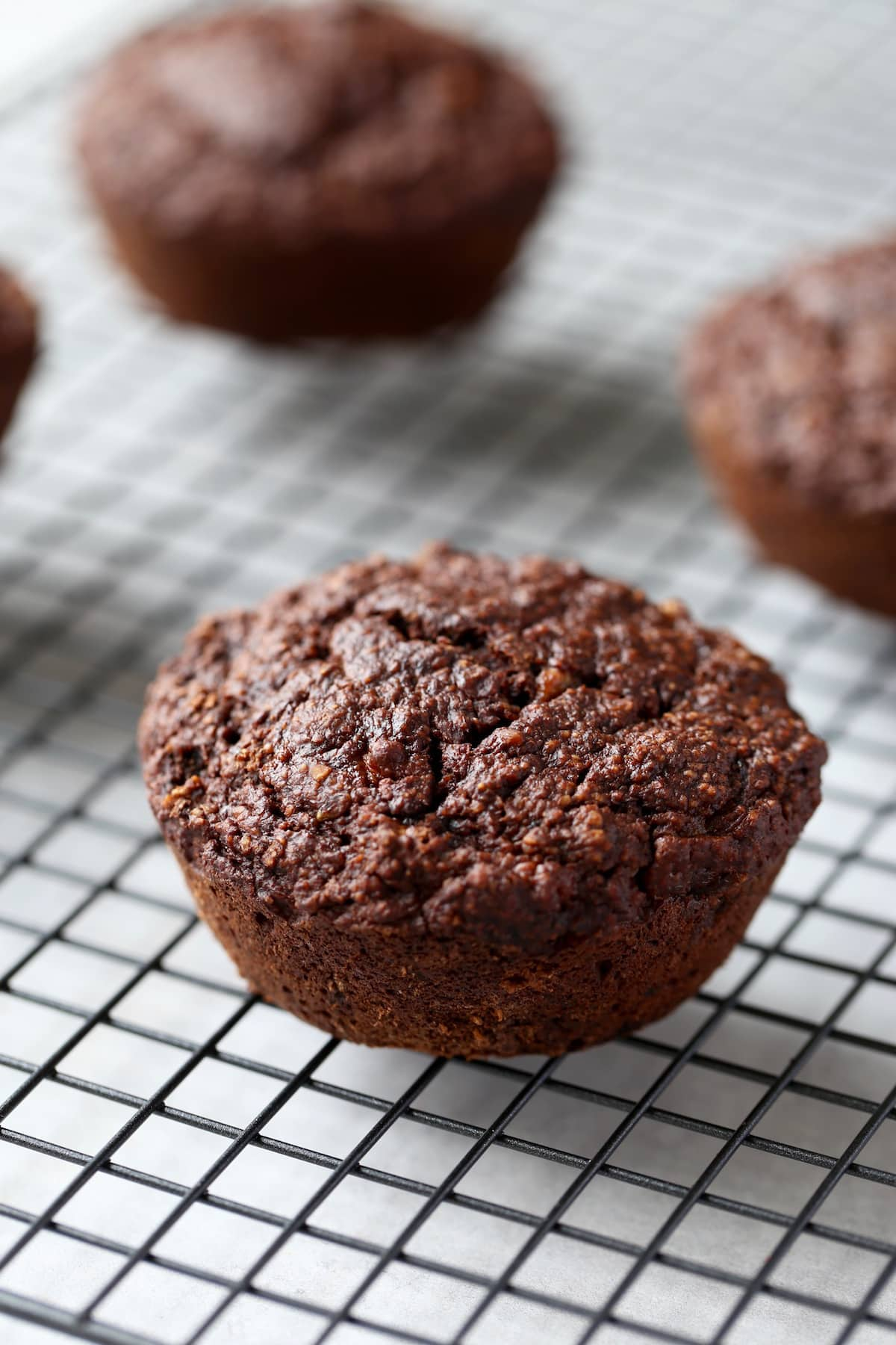 jumbo chocolate muffins cooling on a wire rack