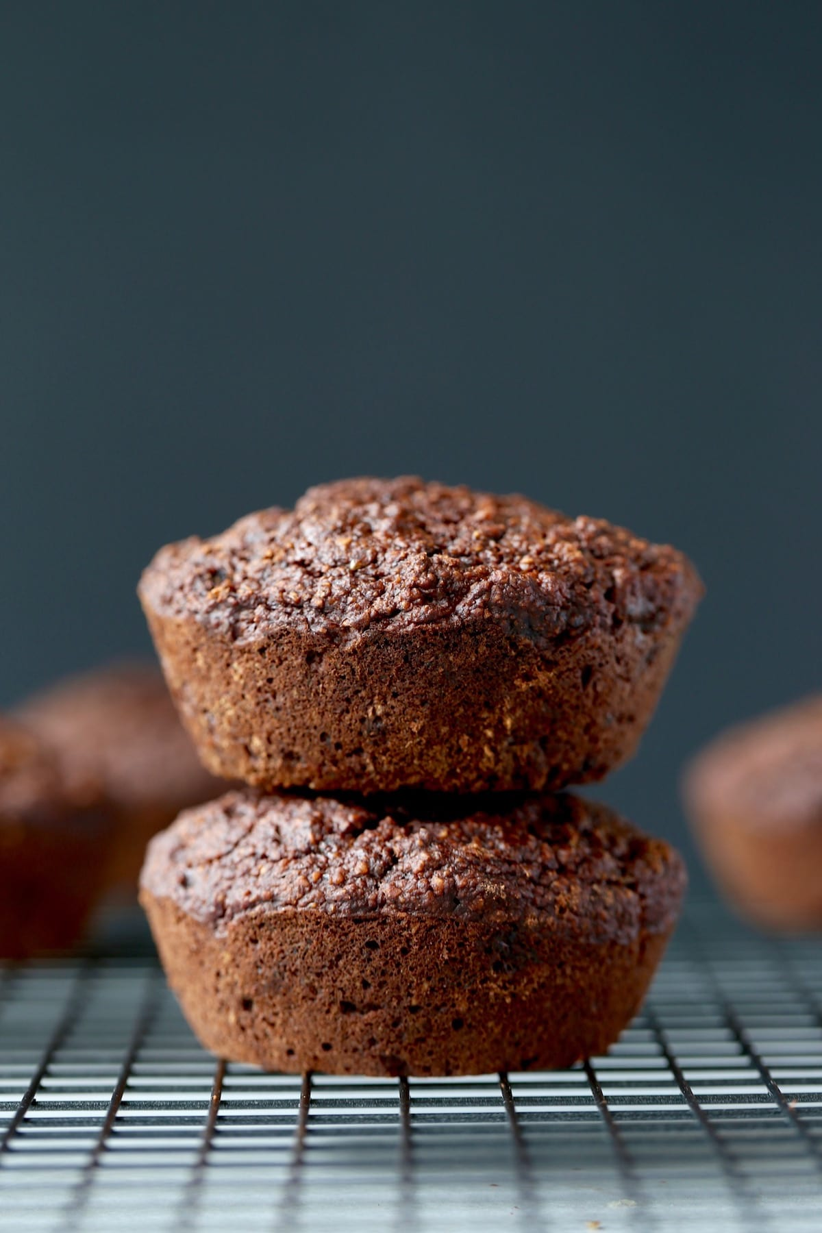 two jumbo chocolate muffins stacked on each other