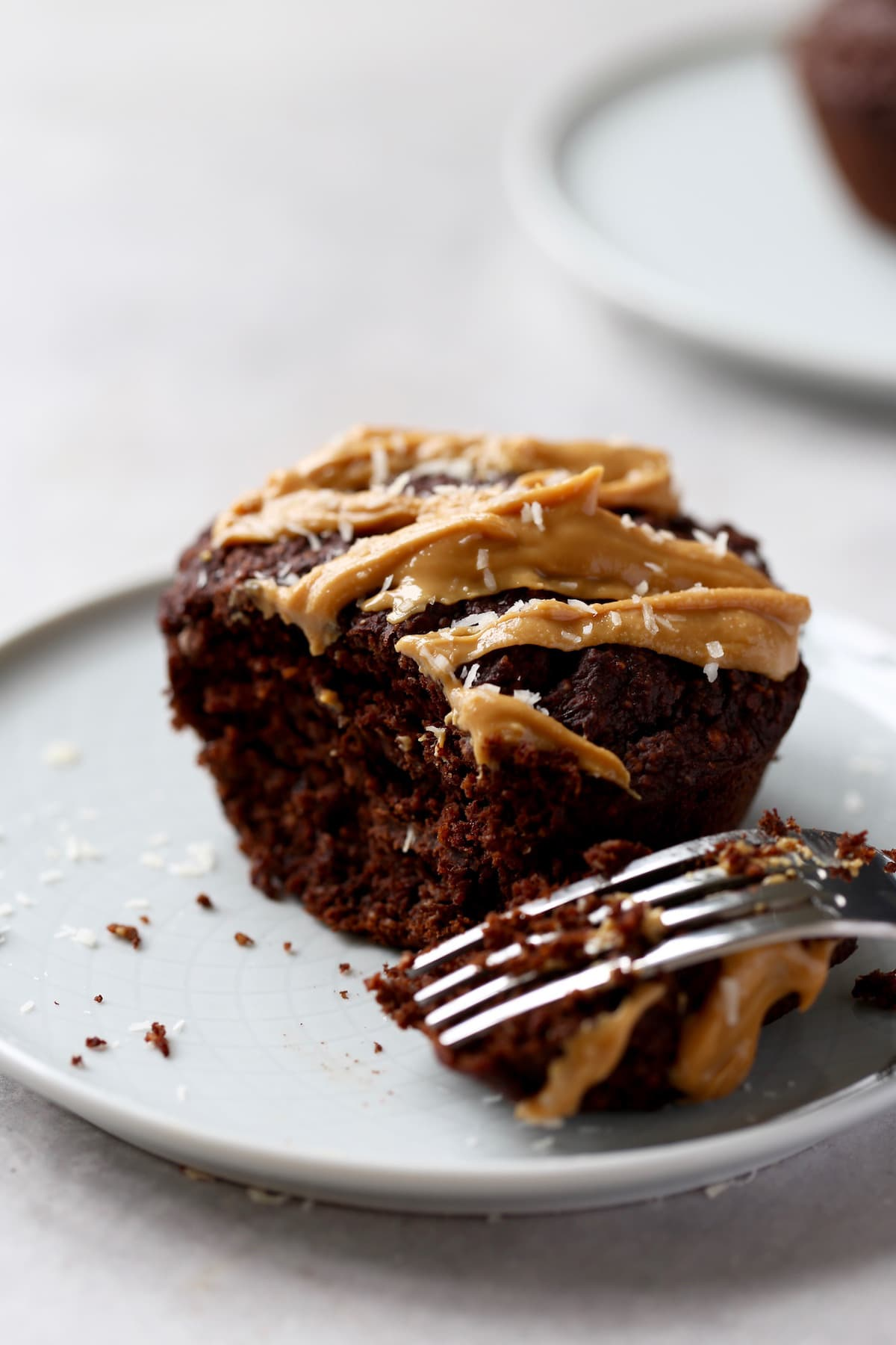 a jumbo chocolate breakfast muffin drizzled with peanut butter