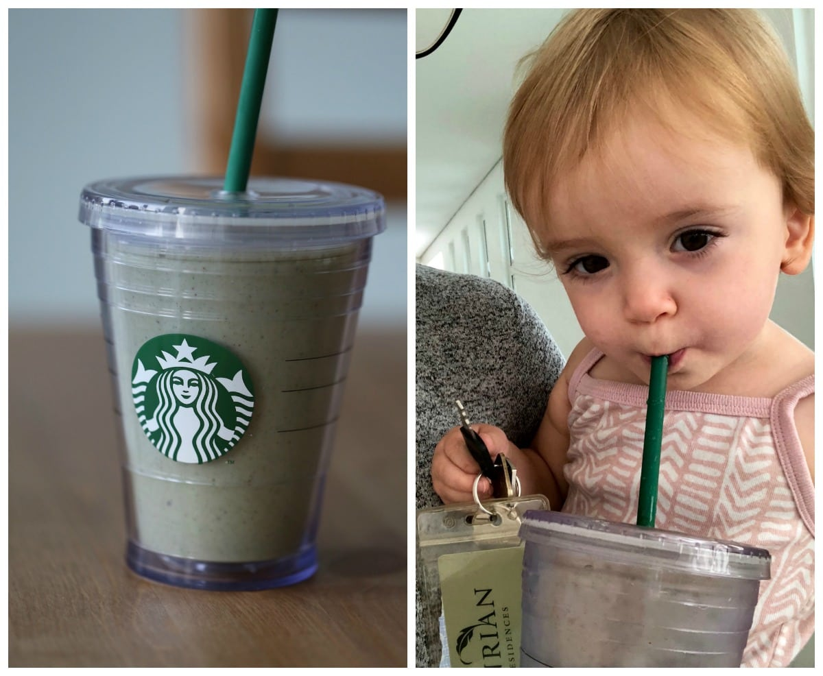 a toddler drinking a green smoothie