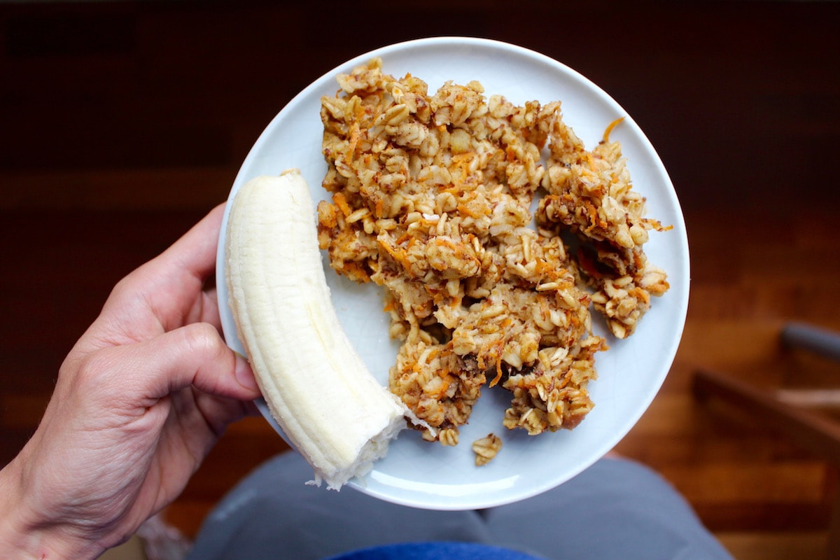 carrot cake baked oatmeal and half a banana on a plate