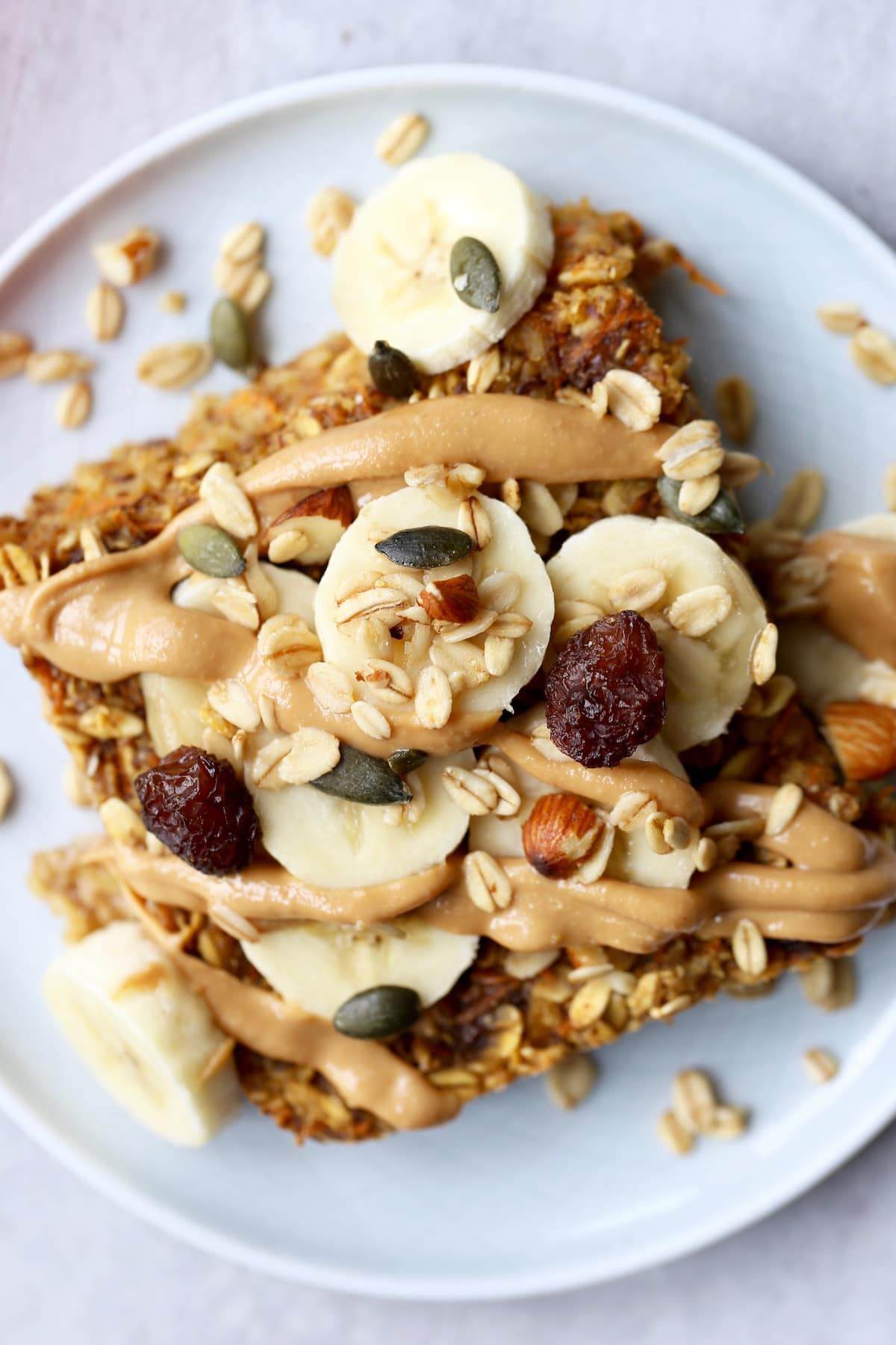 carrot caked baked oatmeal topped with peanut butter and banana