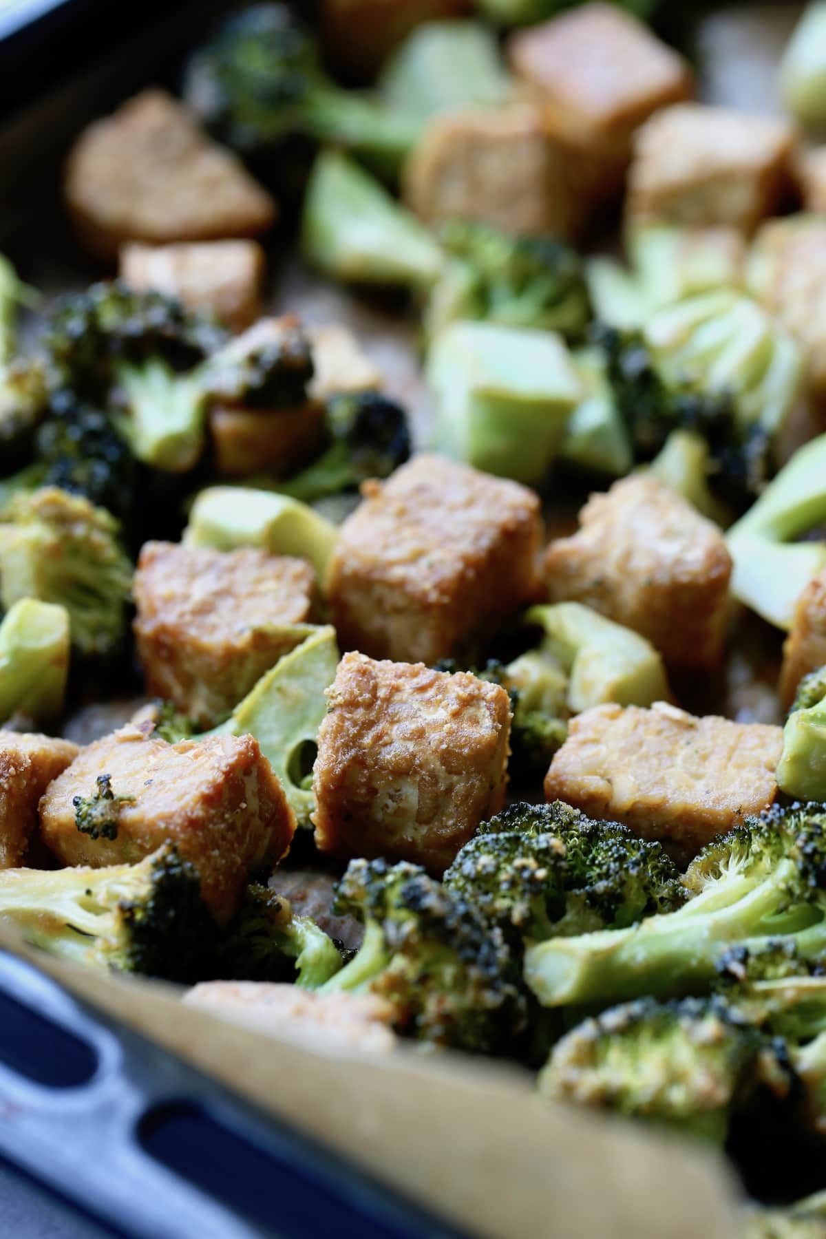 roasted tempeh and broccoli on a sheet pan
