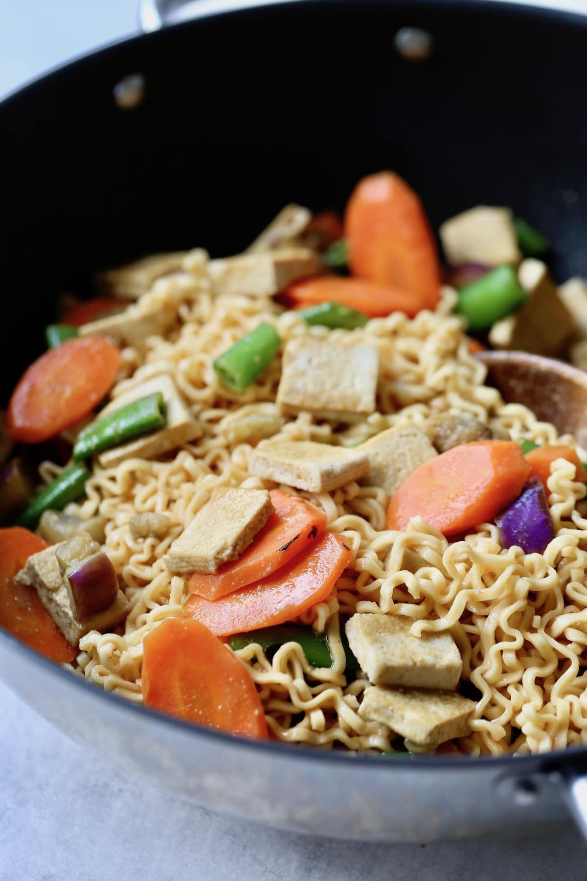 miso noodles, veggies and tofu in a wok