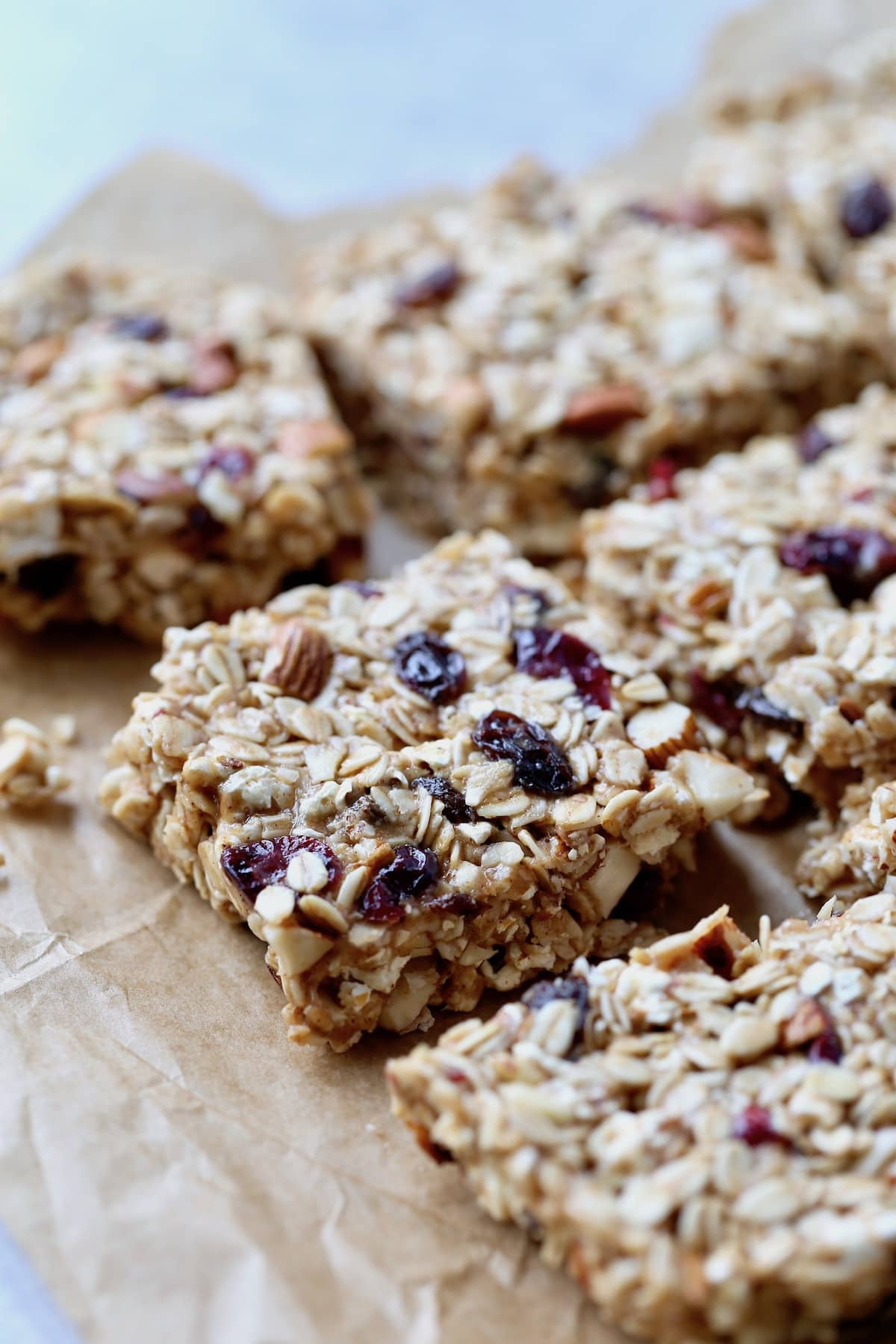 chewy popcorn granola bars cut up on parchment paper