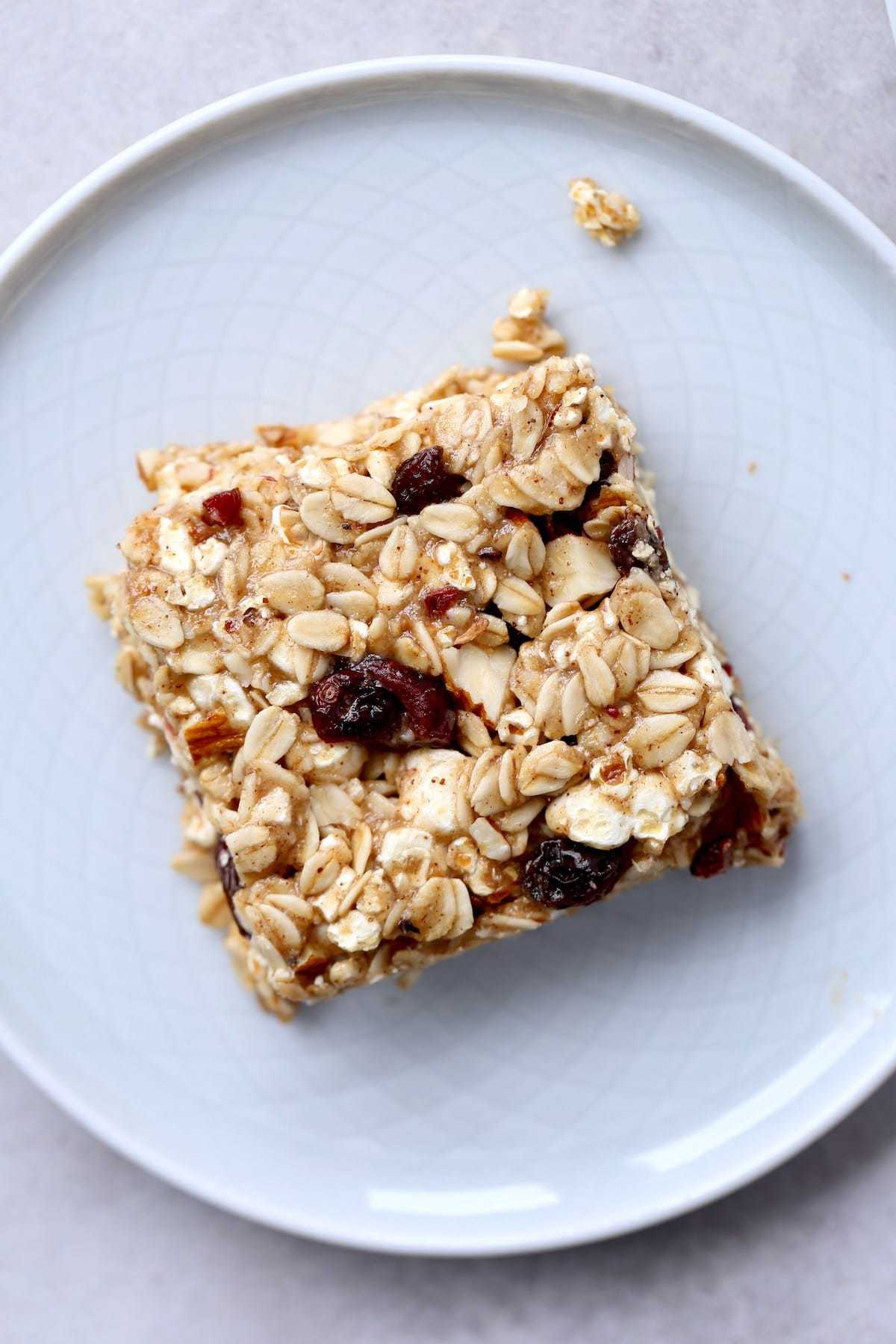 A chewy, craisin studded popcorn granola bar on a plate