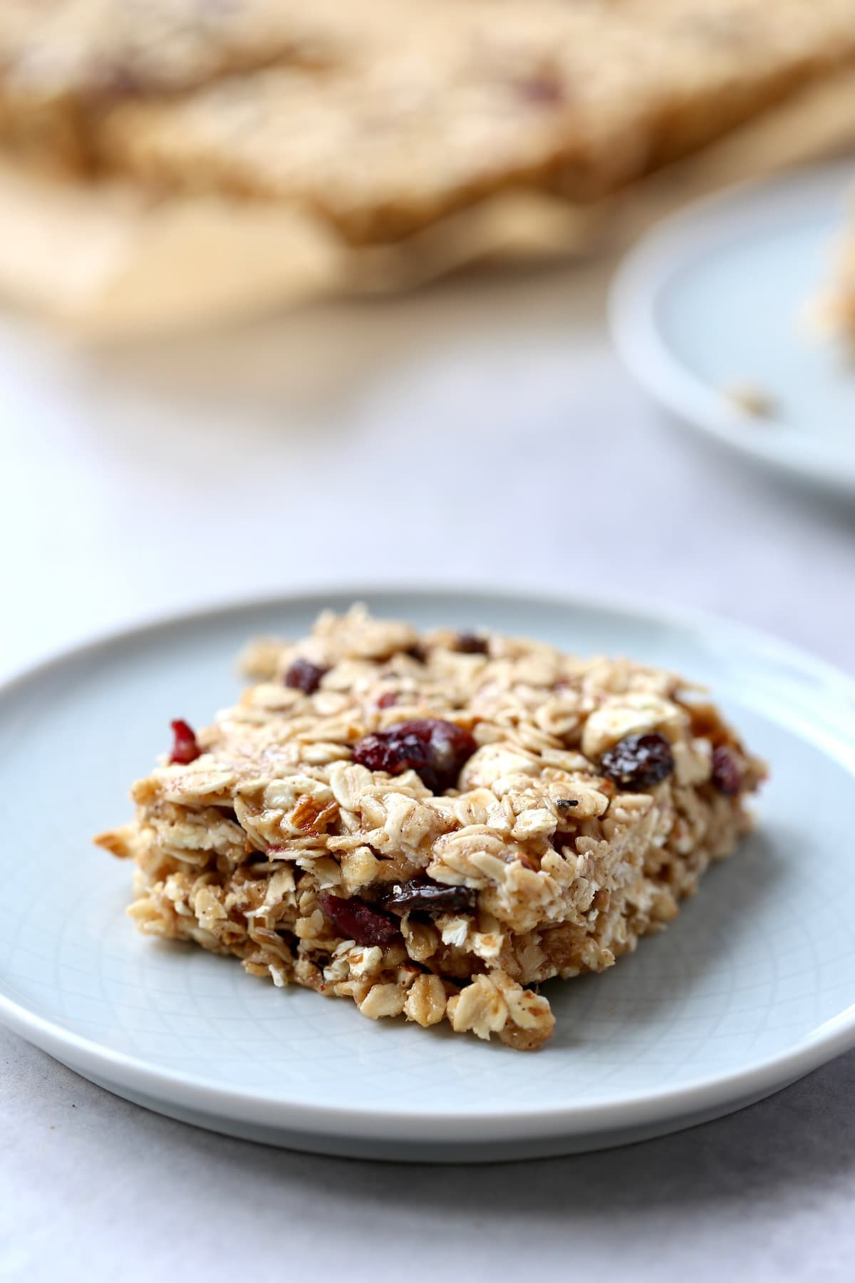 a thick, chewy homemade popcorn granola bar on a plate