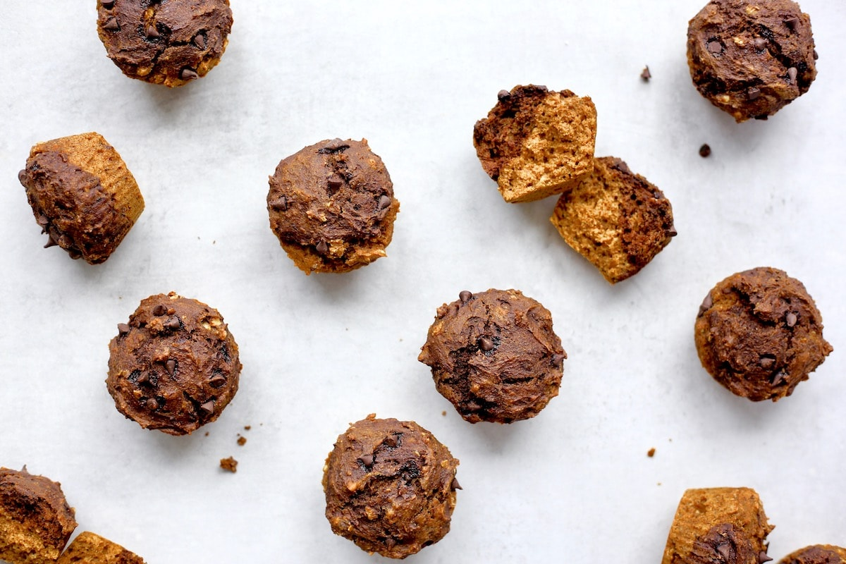 Vegan Pumpkin and Chocolate Layered Muffins spread out on a table