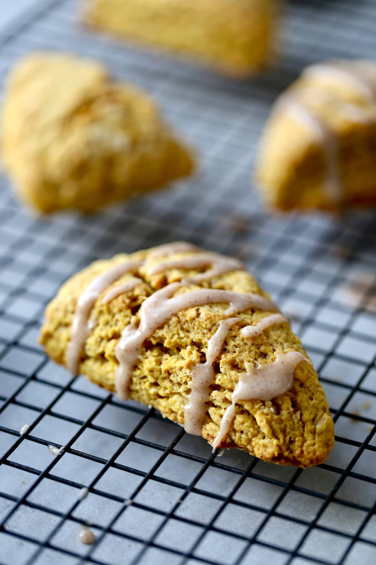 flaky pumpkin scone with cinnamon glaze