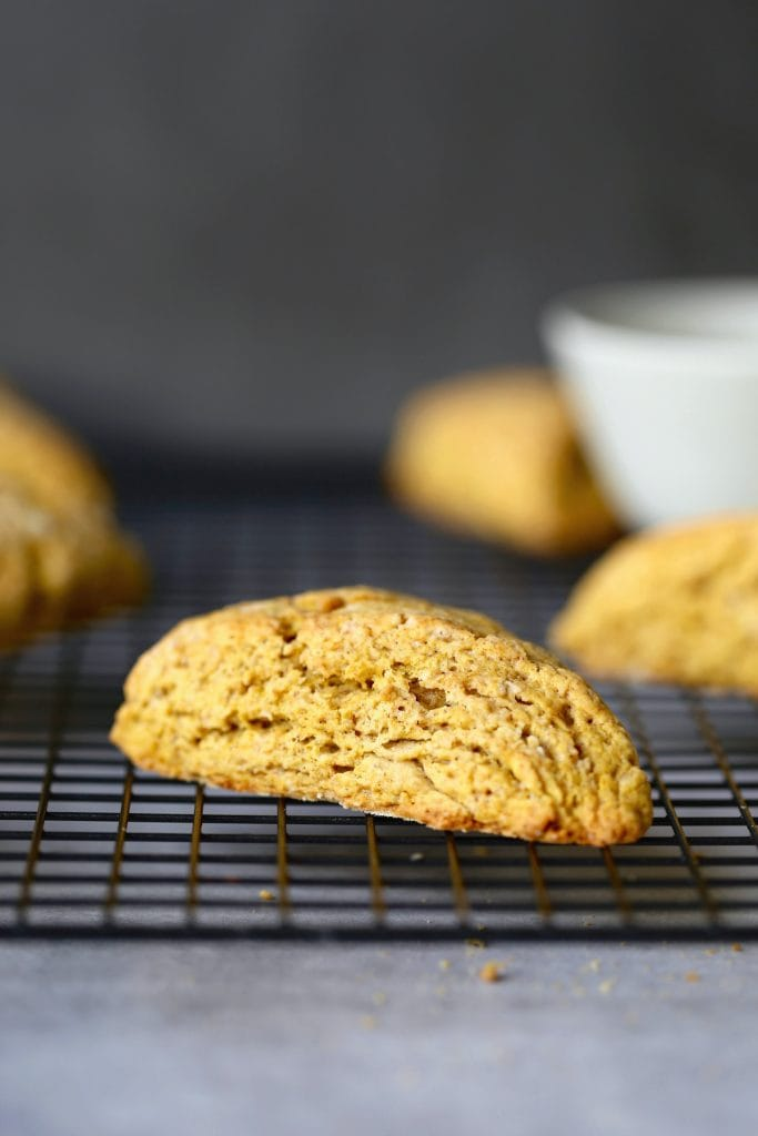 flaky pumpkin scone cooling on a wire rack
