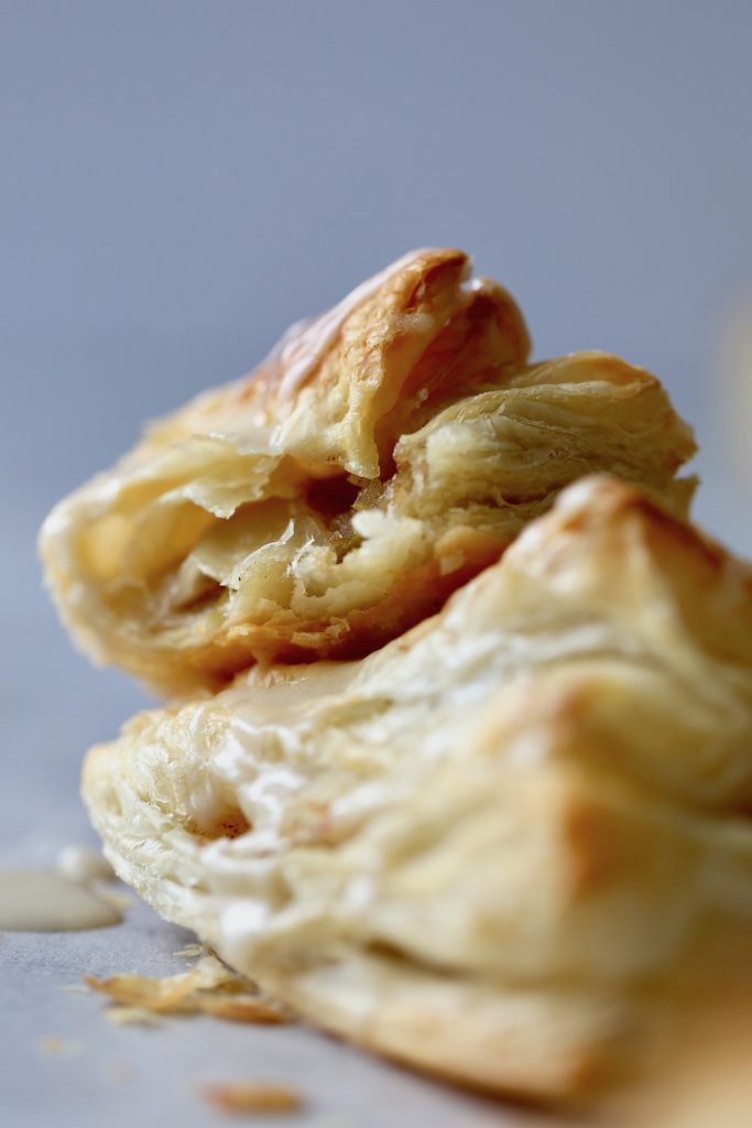 a bite taken out of a vegan apple turnover