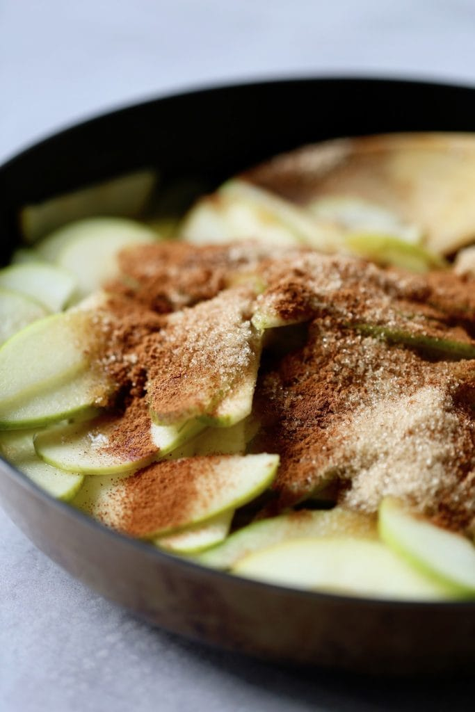 brown sugar coating granny smith apples in a saucepan