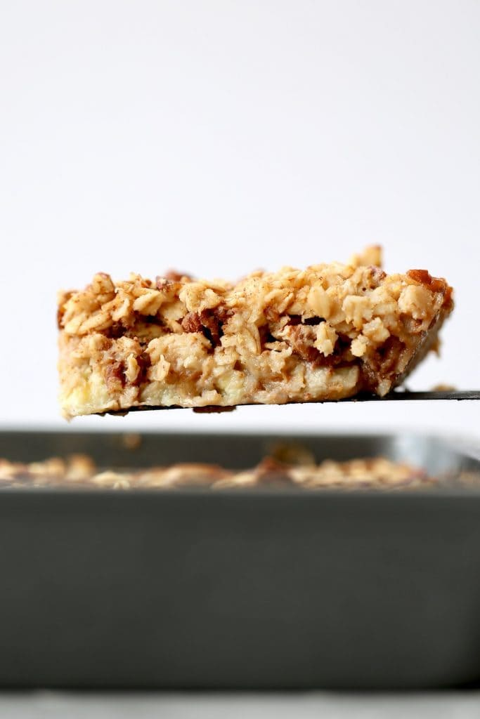a thick slice of maple pecan baked oatmeal on a spatula