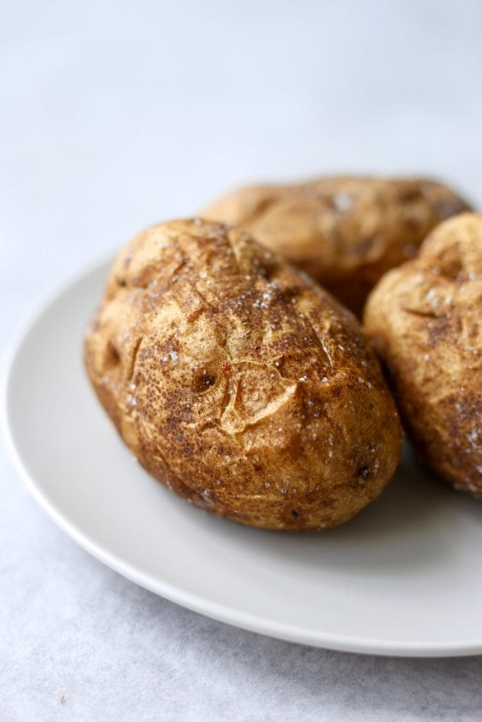 a golden brown baked potato on a plate