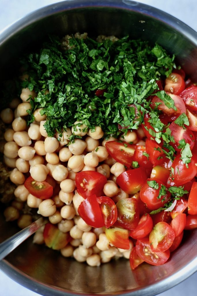 chickpeas, cherry tomatoes and chopped cilantro in a pot