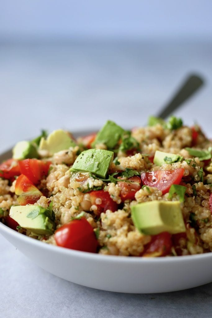 quinoa salad with avocado, chickpeas and tomatoes in a bowl