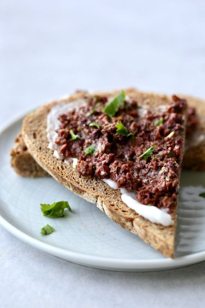 Fresh tapenade on a slice of whole wheat artisan bread