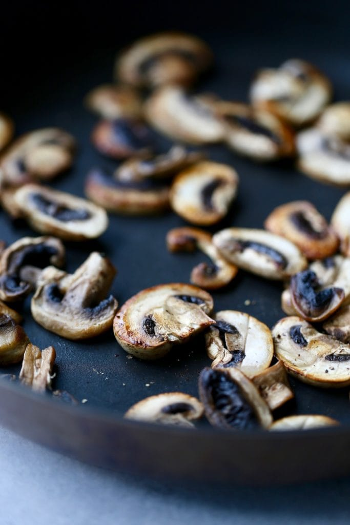 Mushrooms browning on a saute pan