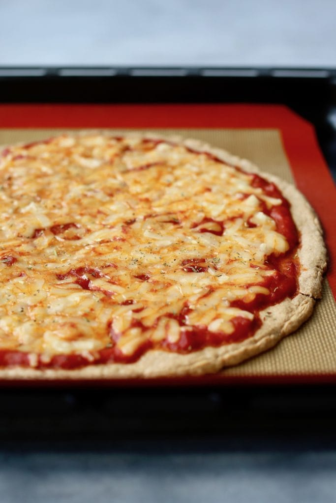 a perfectly baked vegan cheese pizza straight out of the oven