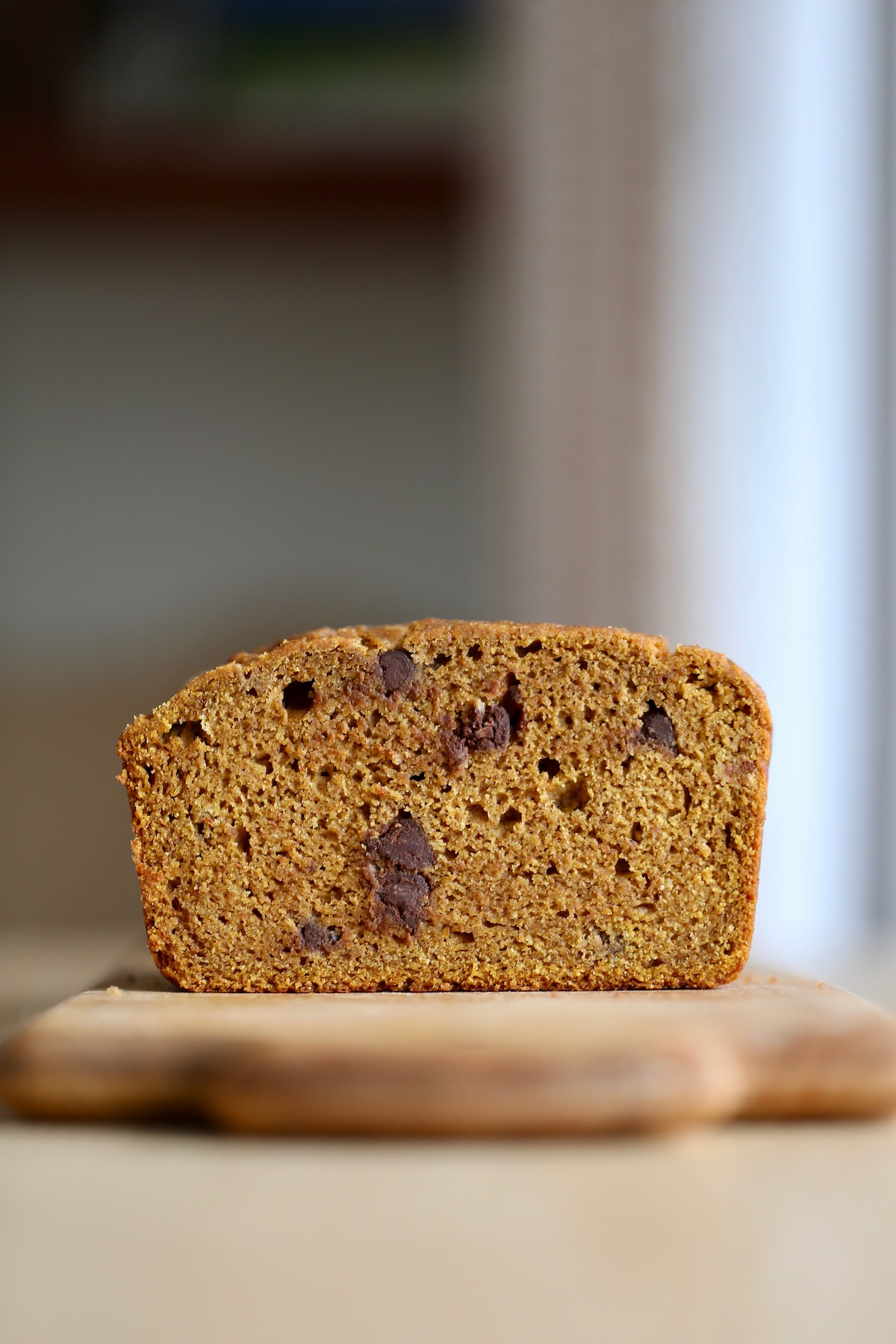 vegan pumpkin chocolate chip quick bread on a cutting board
