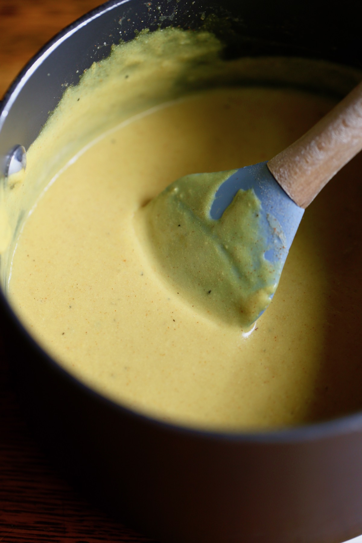 vegan cheese sauce thickening in a saucepan