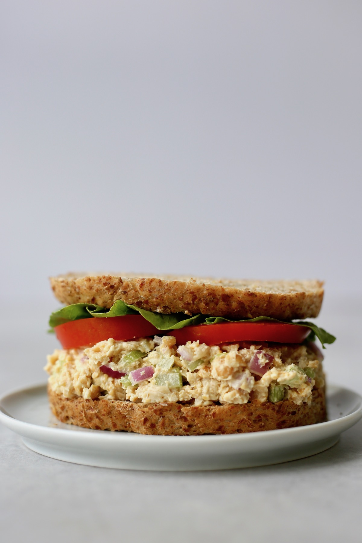 a chickpea salad sandwich with lettuce and tomato