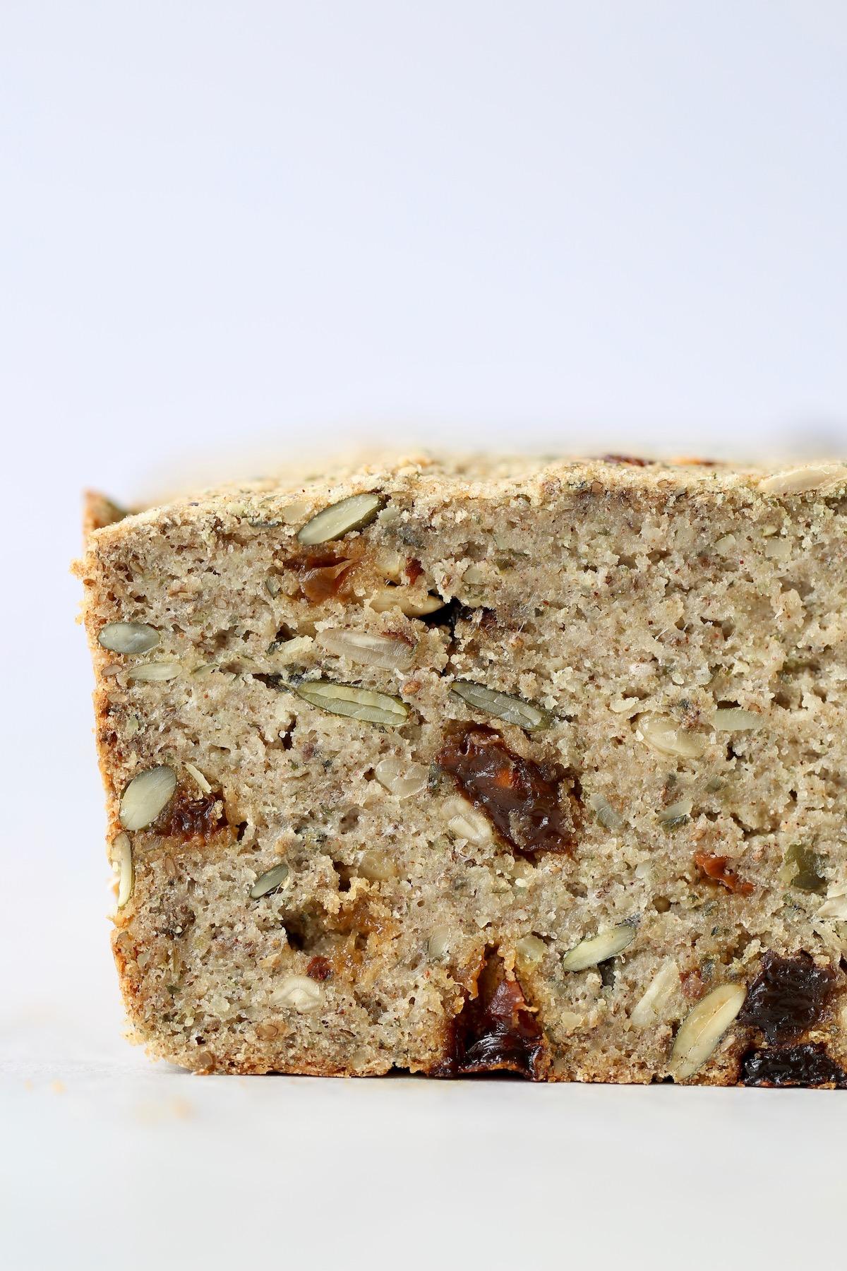 a cross section of gluten-free cinnamon raisin seed bread