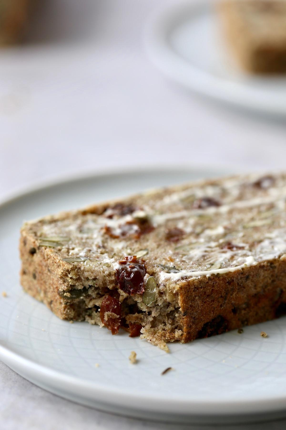a bite taken out of gluten free cinnamon raisin seed bread