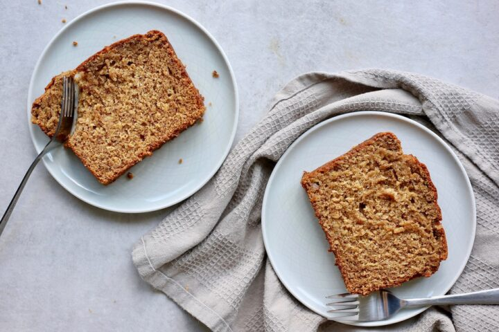 two slices of vegan banana bread served on plates