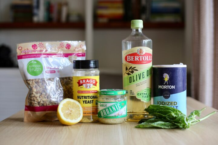 Ingredients you need for classic vegan pesto on a table