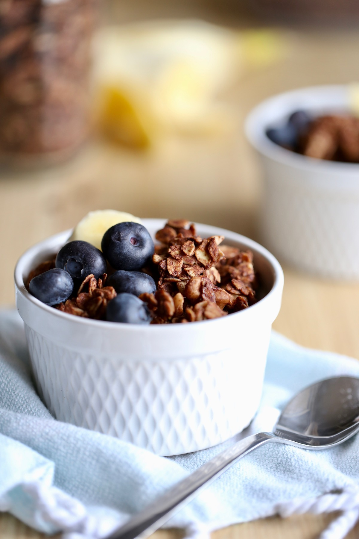 Dark Chocolate granola in a bowl with blueberries