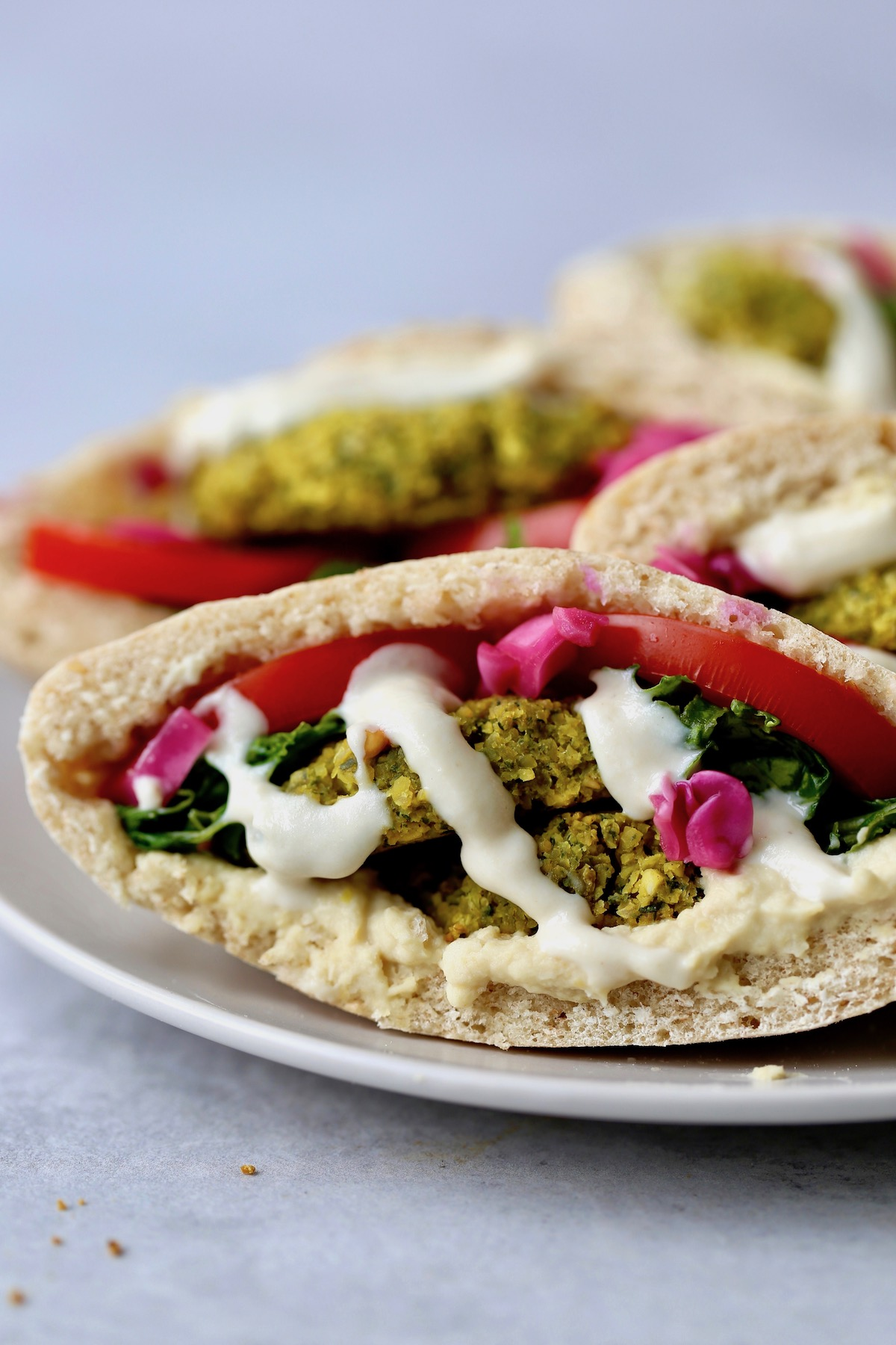 Falafel pitas stuffed with baked falafel, pickled red cabbage and lemon tahini dressing