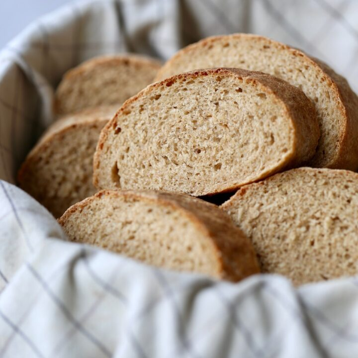 homemade Italian bread cut up and served in a basket