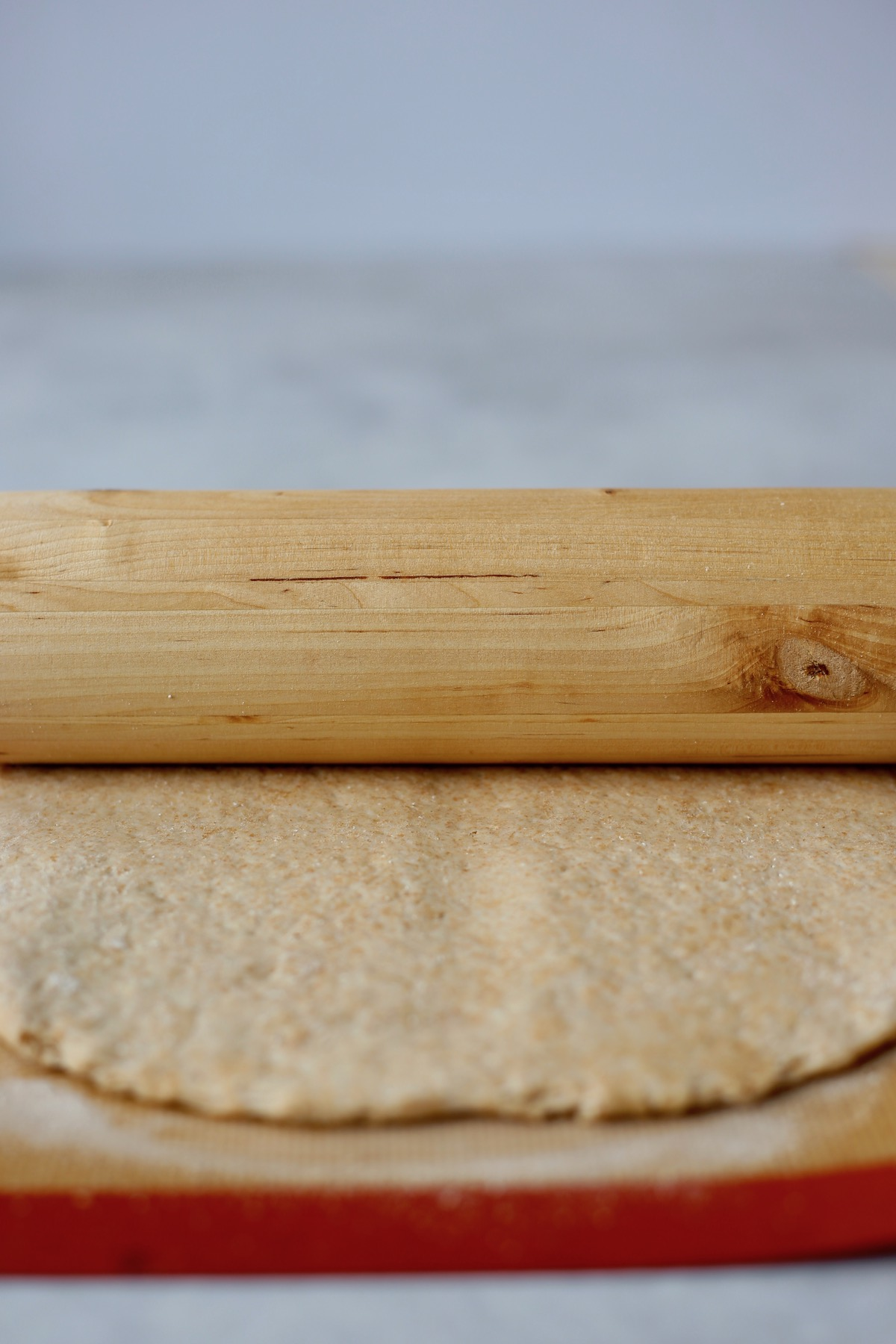 roll the dough with a rolling pin