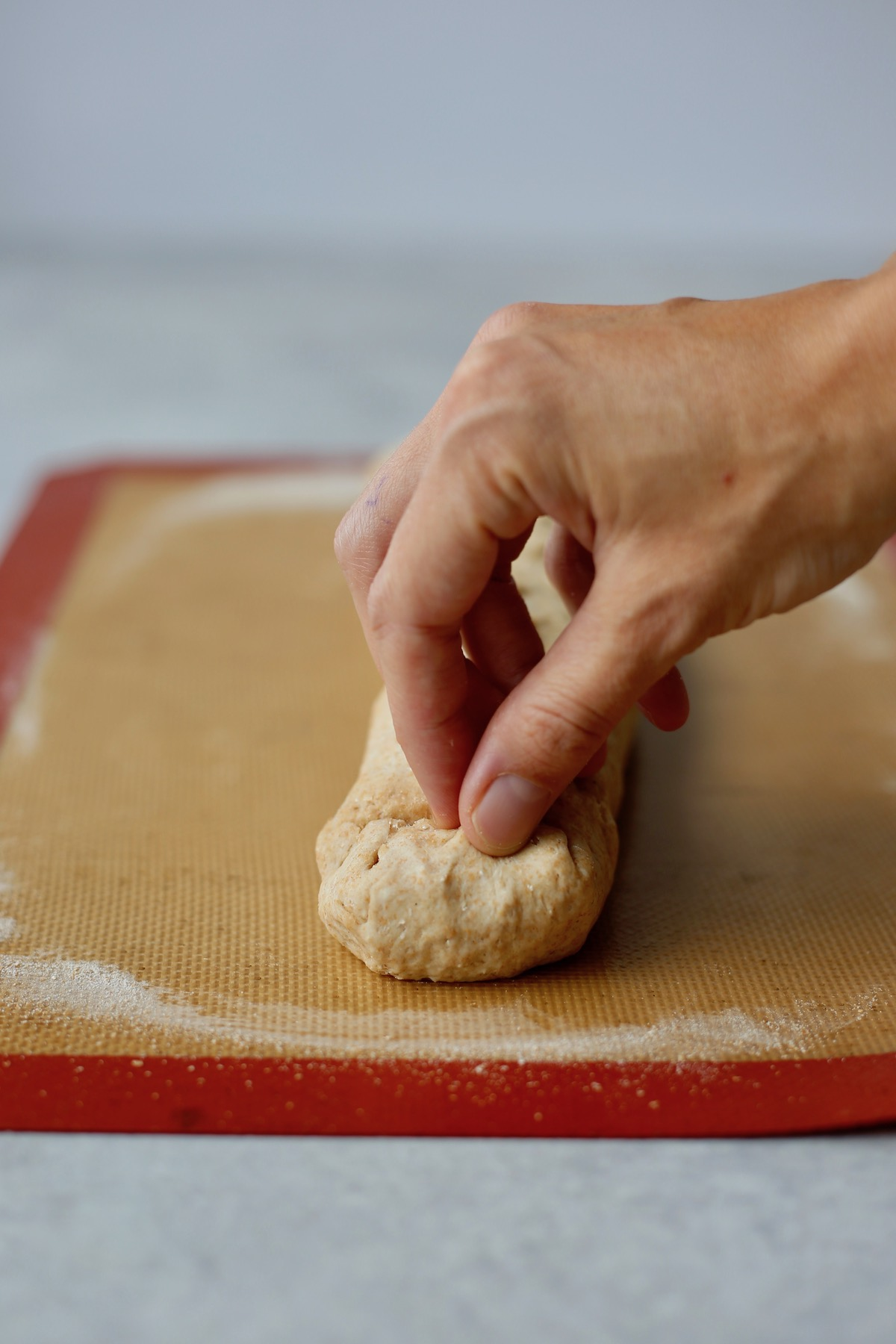 pinch the ends of the dough roll