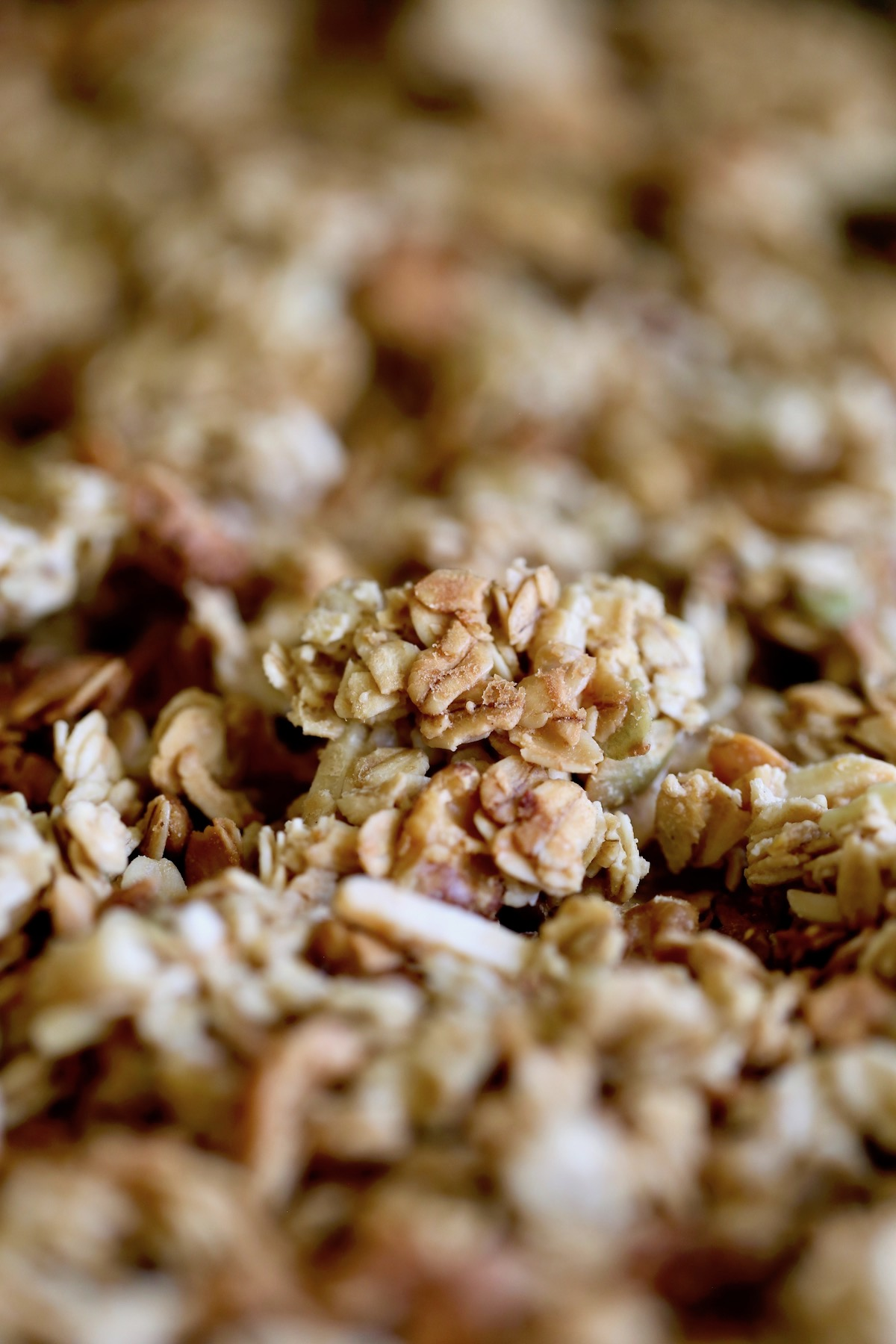 a huge cluster of Tahini Granola on a baking sheet