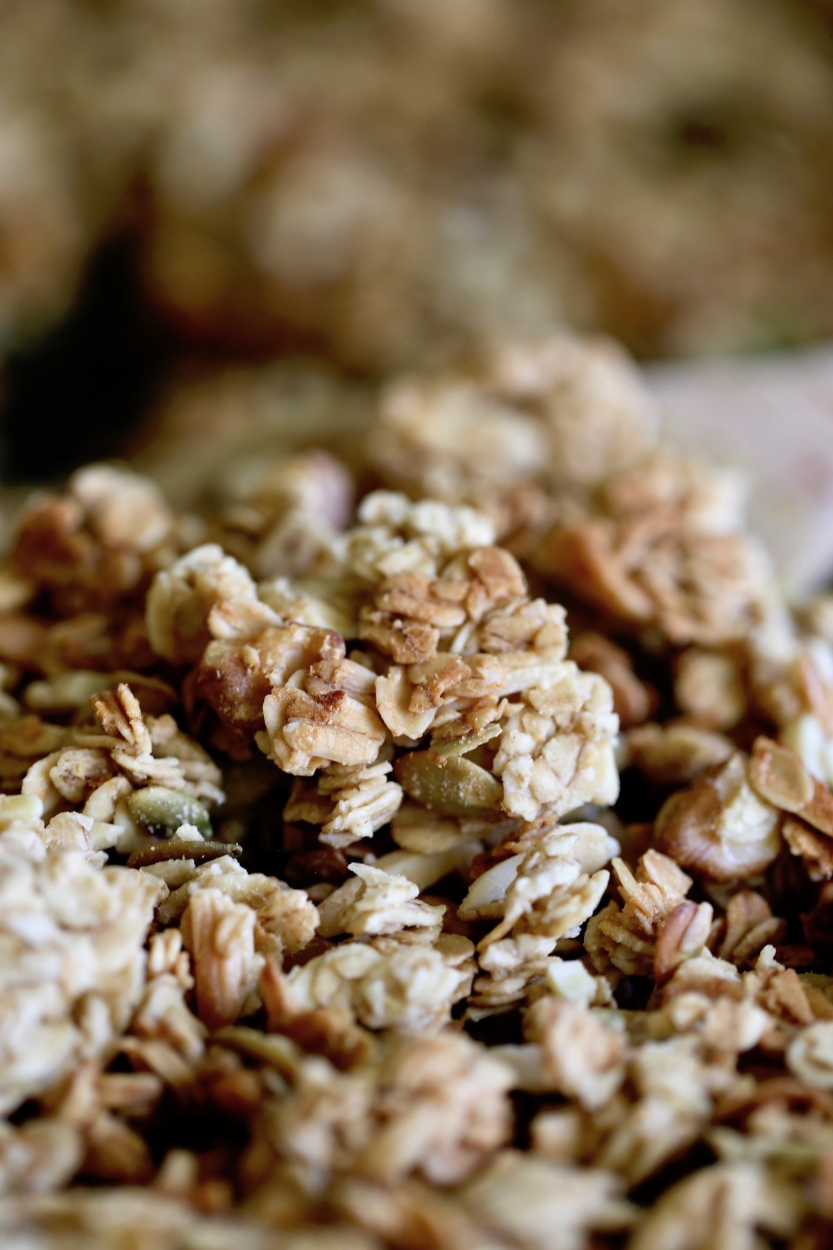 clustery tahini granola on a baking sheet