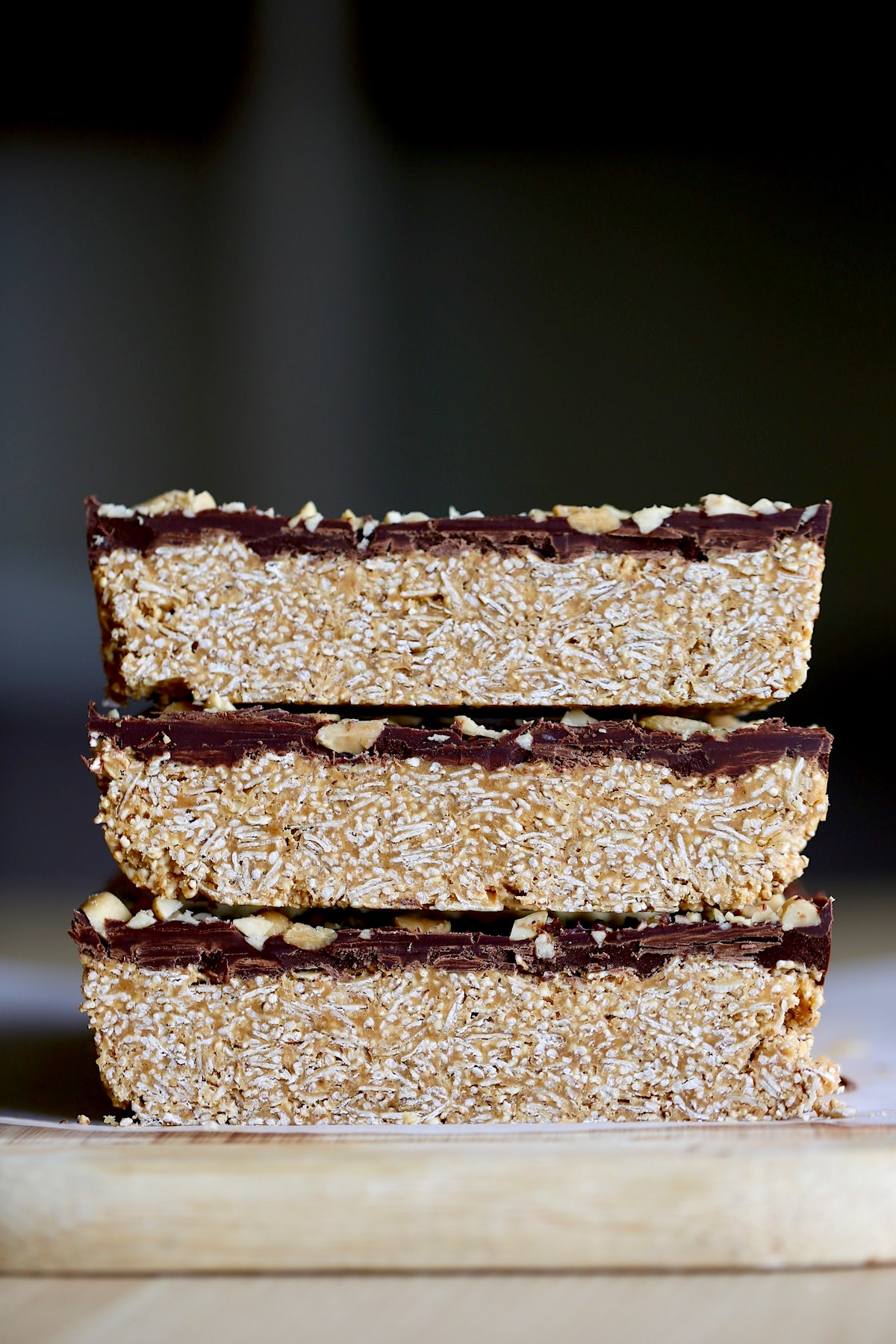 three healthier peanut butter bars stacked on top of each other