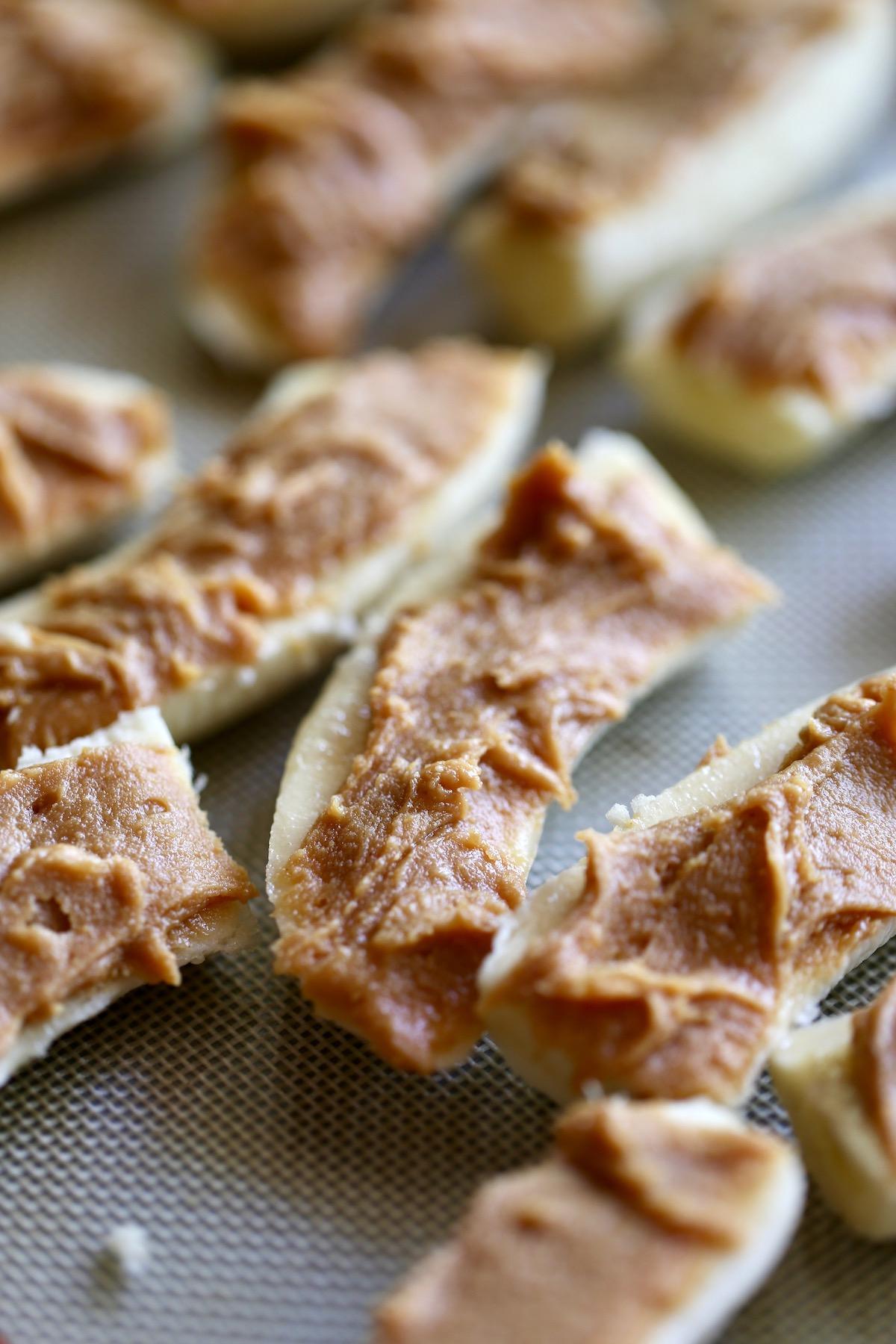 sweet peanut butter spread on sliced banana