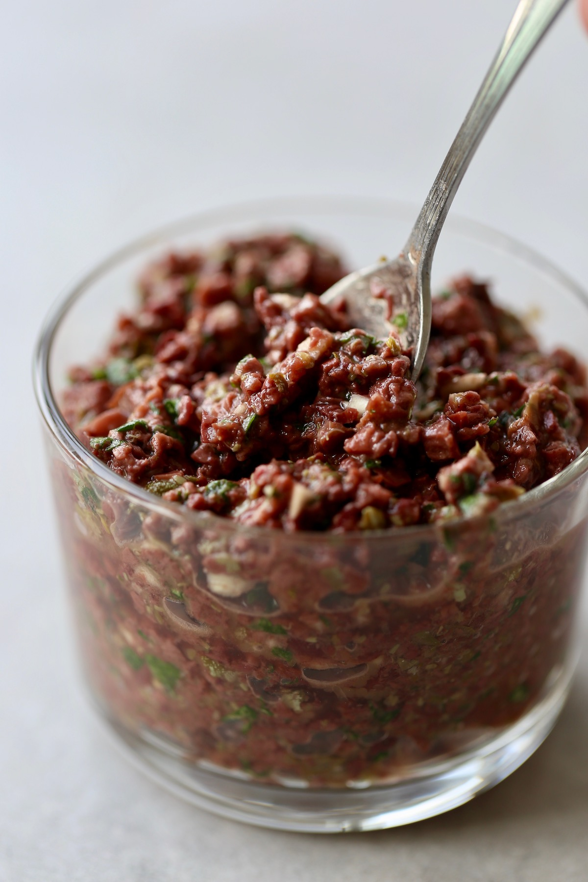 Homemade tapenade in a clear glass