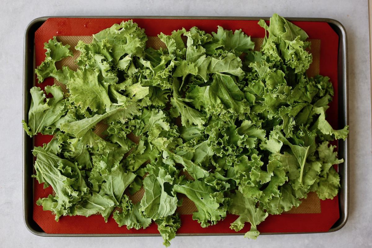raw kale on a baking sheet