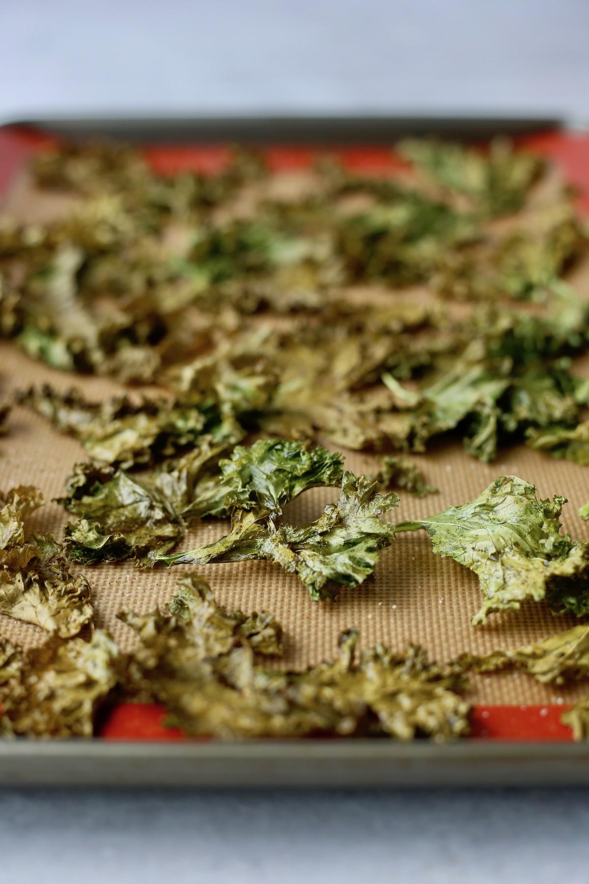 crispy kale chips on a baking sheet