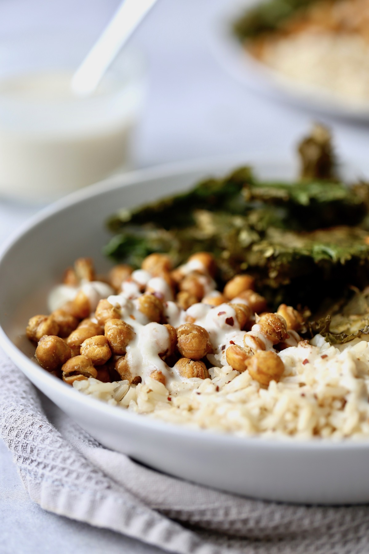 lemon tahini dressing drizzled over crispy chickpeas and brown rice
